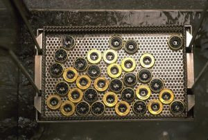 Degreasing bearings in a vapor degreaser with 3M Novec Engineered Fluids
